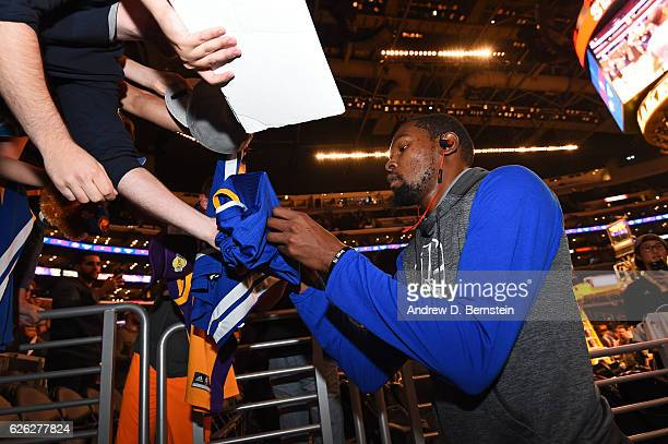 Kevin Durant of the Golden State Warriors signs autographs before the game at the Staples Center against the Los Angeles Lakers on November 25 2016...