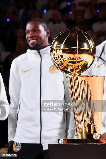 Kevin Durant of the Golden State Warriors smiles during the 2017 NBA Championship ring ceremony before the game against the Houston Rockets on...