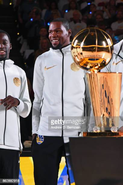 Kevin Durant of the Golden State Warriors smiles during the ring ceremony before the game against the Houston Rockets on October 17 2017 at ORACLE...