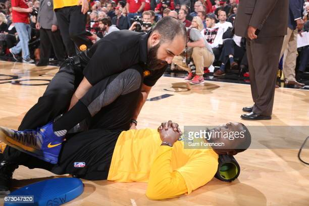 Kevin Durant of the Golden State Warriors stretches before the game against the Portland Trail Blazers during Game Four of the Western Conference...