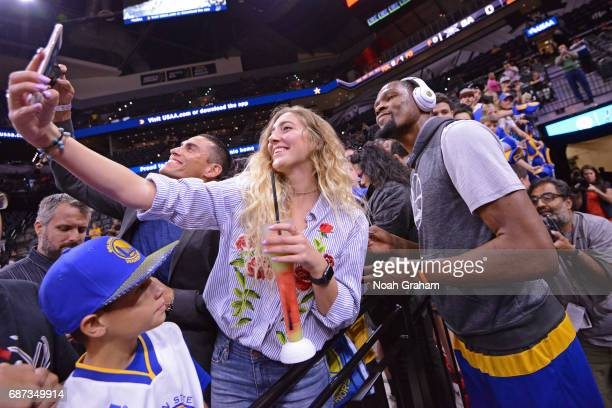 Kevin Durant of the Golden State Warriors takes a selfie with a fan before Game Four of the Western Conference Finals against the San Antonio Spurs...