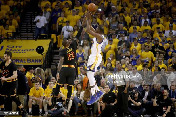 Kevin Durant of the Golden State Warriors takes a shot against LeBron James of the Cleveland Cavaliers in Game 2 of the 2017 NBA Finals at ORACLE...