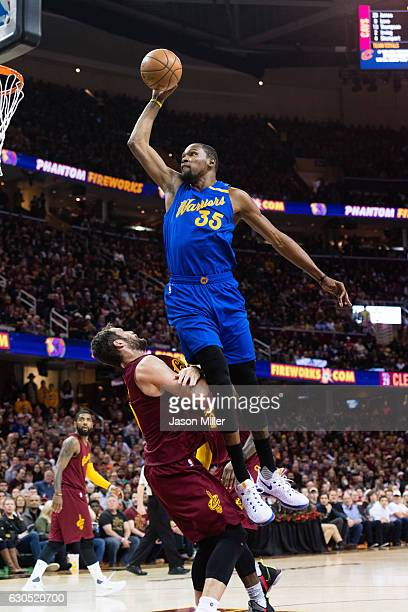 Kevin Durant of the Golden State Warriors tries to dunk over Kevin Love of the Cleveland Cavaliers during the first half at Quicken Loans Arena on...