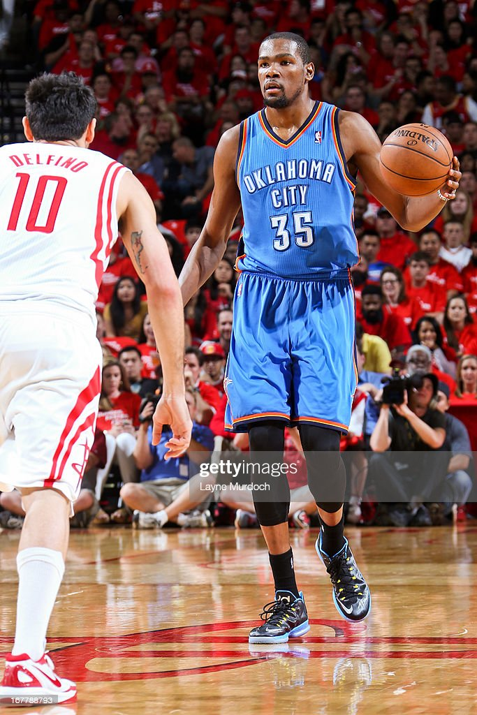 Kevin Durant #35 of the Oklahoma City Thunder advances the ball against Carlos Delfino #10 of the Houston Rockets in Game Four of the Western Conference Quarterfinals during the 2013 NBA Playoffs on April 29, 2013 at the Toyota Center in Houston, Texas.