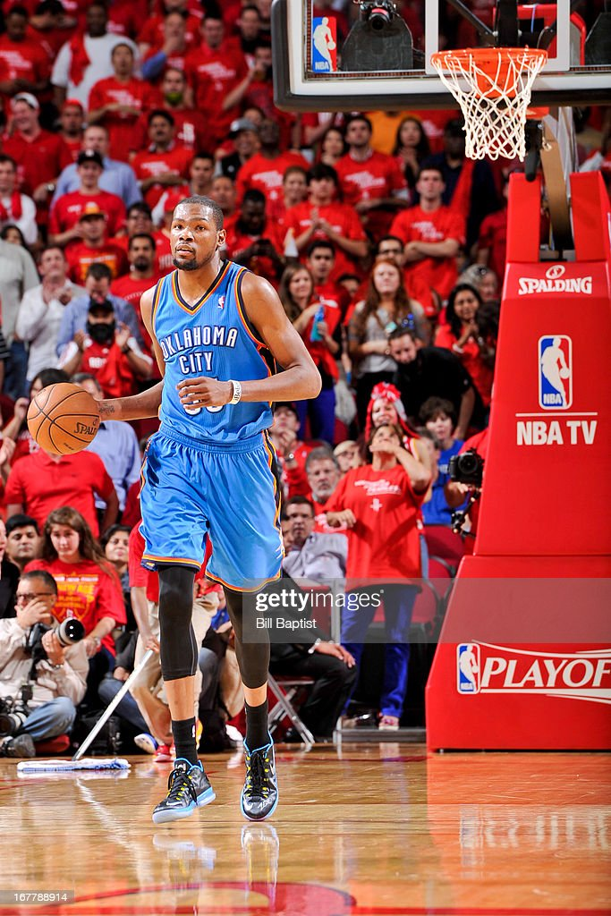 <a gi-track='captionPersonalityLinkClicked' href=/galleries/search?phrase=Kevin+Durant&family=editorial&specificpeople=3847329 ng-click='$event.stopPropagation()'>Kevin Durant</a> #35 of the Oklahoma City Thunder advances the ball against the Houston Rockets in Game Four of the Western Conference Quarterfinals during the 2013 NBA Playoffs on April 29, 2013 at the Toyota Center in Houston, Texas.