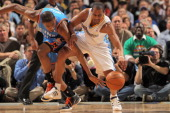 Kevin Durant of the Oklahoma City Thunder and Arron Afflalo of the Denver Nuggets battle for control of the ball in Game Three of the Western...