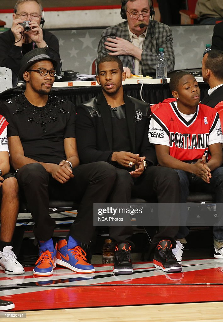 Kevin Durant of the Oklahoma City Thunder and Chris Paul sit courtside during the Sears Shooting Stars on State Farm All-Star Saturday Night during NBA All Star Weekend on February 16, 2013 at the Toyota Center in Houston, Texas.
