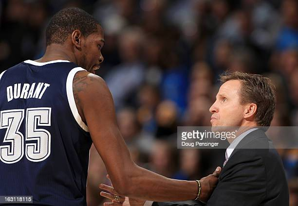 Kevin Durant of the Oklahoma City Thunder and head coach Scott Brooks of the Oklahoma City Thunder talk during a time out against the Denver Nuggets...
