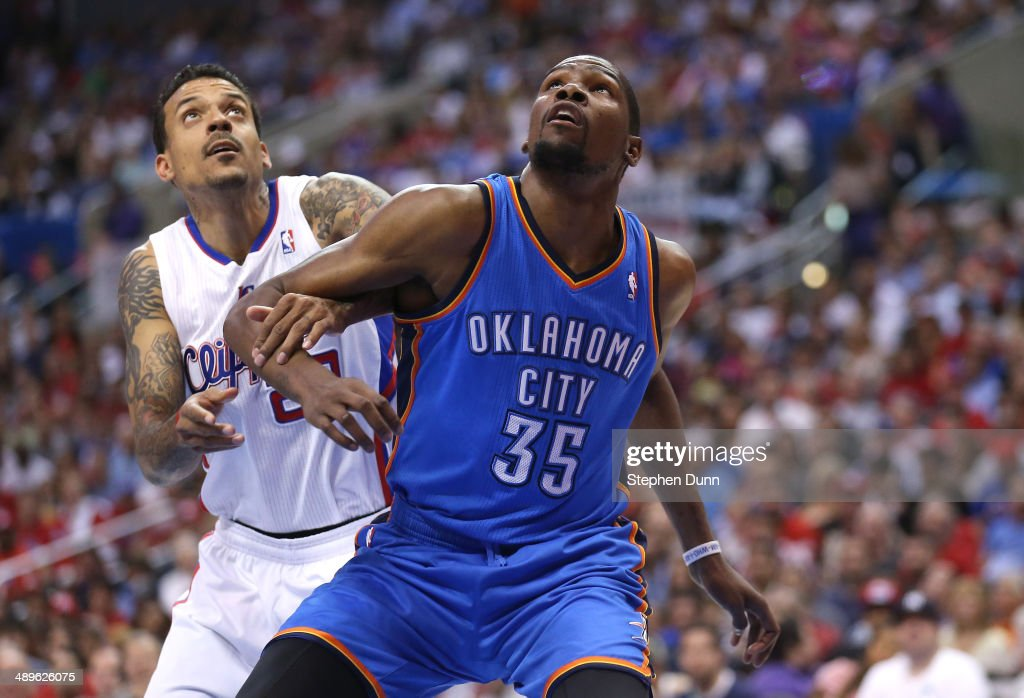Kevin Durant #35 of the Oklahoma City Thunder and Matt Barnes #22 of the Los Angeles Clippers fight for position under the boards in Game Four of the Western Conference Semifinals during the 2014 NBA Playoffs at Staples Center on May 11, 2014 in Los Angeles, California. The Clippers won 101-99.