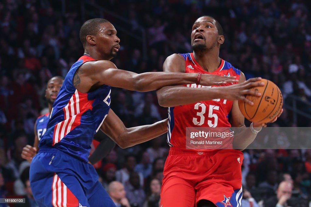 Kevin Durant #35 of the Oklahoma City Thunder and the Western Conference drives as Chris Bosh #1 of the Miami Heat and the Eastern Conference goes for the steal in the first quarter during the 2013 NBA All-Star game at the Toyota Center on February 17, 2013 in Houston, Texas.
