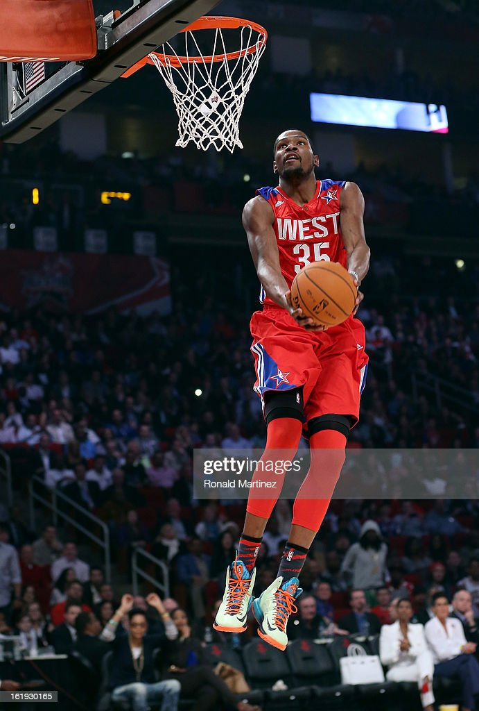 Kevin Durant #35 of the Oklahoma City Thunder and the Western Conference goes up for a reverse dunk in the first quarter during the 2013 NBA All-Star game at the Toyota Center on February 17, 2013 in Houston, Texas.