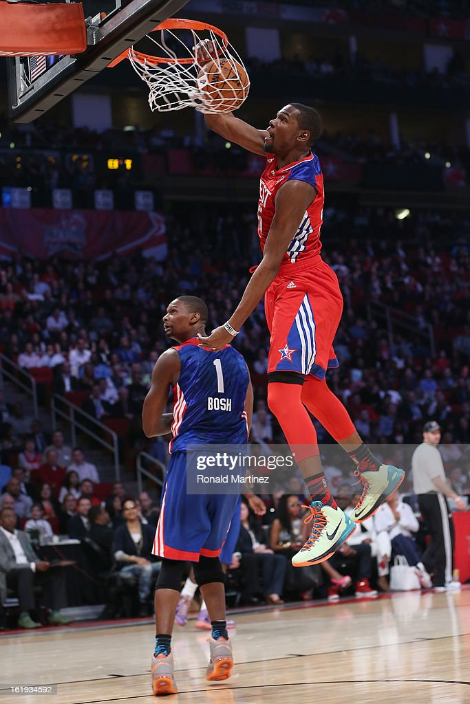 Kevin Durant #35 of the Oklahoma City Thunder and the Western Conference dunks over Chris Bosh #1 of the Miami Heat and the Eastern Conference during the 2013 NBA All-Star game at the Toyota Center on February 17, 2013 in Houston, Texas.