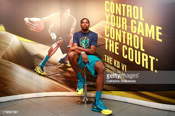 Kevin Durant of the Oklahoma City Thunder answers questions from winners of a design contest at a Nike store during the KDI Tour on September 5 2013...