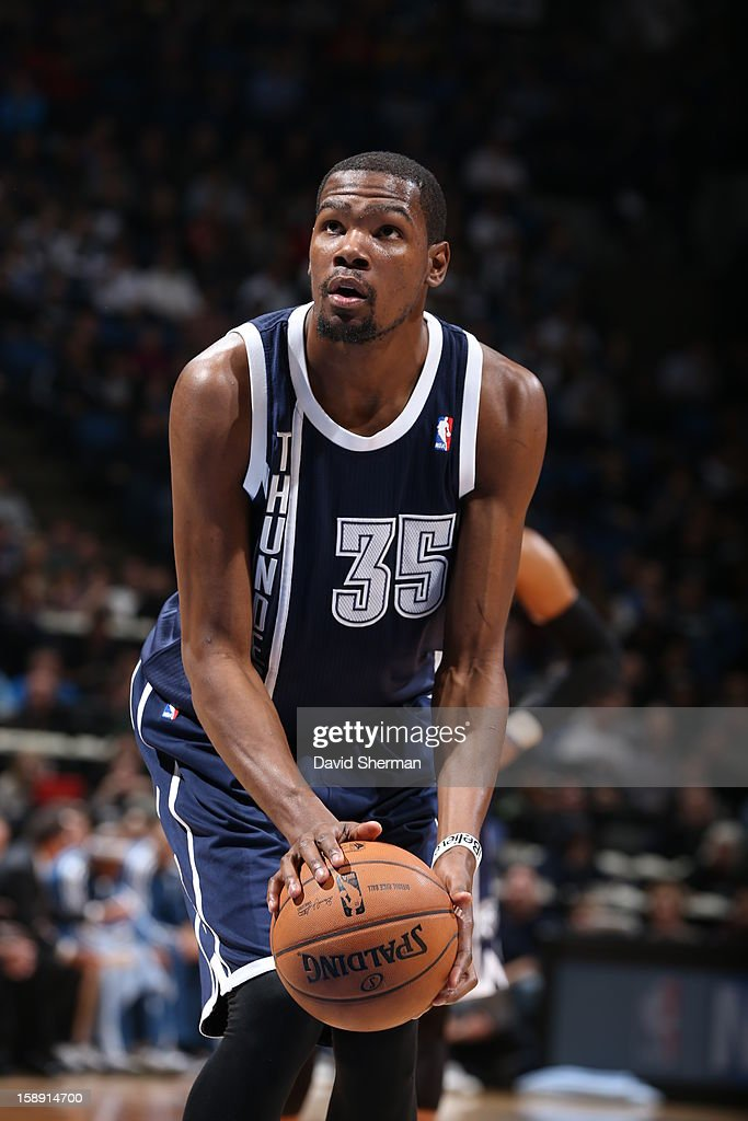 <a gi-track='captionPersonalityLinkClicked' href=/galleries/search?phrase=Kevin+Durant&family=editorial&specificpeople=3847329 ng-click='$event.stopPropagation()'>Kevin Durant</a> #35 of the Oklahoma City Thunder attempts a foul shot against the Minnesota Timberwolves on December 20, 2012 at Target Center in Minneapolis, Minnesota.