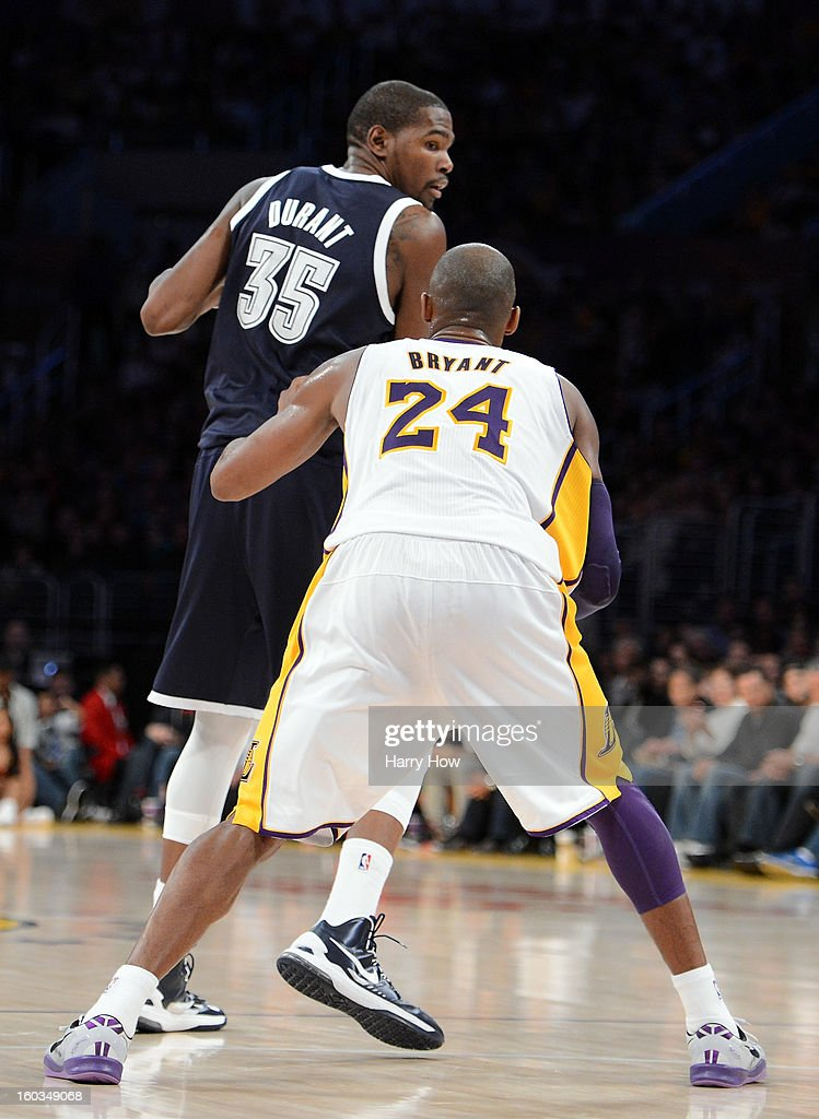 Kevin Durant #35 of the Oklahoma City Thunder backs in on Kobe Bryant #24 of the Los Angeles Lakers at Staples Center on January 27, 2013 in Los Angeles, California.