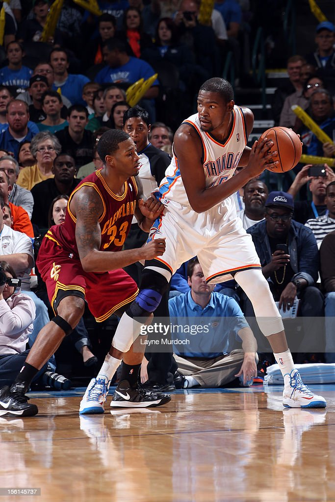 <a gi-track='captionPersonalityLinkClicked' href=/galleries/search?phrase=Kevin+Durant&family=editorial&specificpeople=3847329 ng-click='$event.stopPropagation()'>Kevin Durant</a> #35 of the Oklahoma City Thunder backs up <a gi-track='captionPersonalityLinkClicked' href=/galleries/search?phrase=Alonzo+Gee&family=editorial&specificpeople=801443 ng-click='$event.stopPropagation()'>Alonzo Gee</a> #33 of the Cleveland Cavaliers during an NBA game on November 11, 2012 at the Chesapeake Energy Arena in Oklahoma City, Oklahoma.