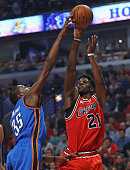 Kevin Durant of the Oklahoma City Thunder blocks a shot by Jimmy Butler of the Chicago Bulls at the United Center on November 5 2015 in Chicago...
