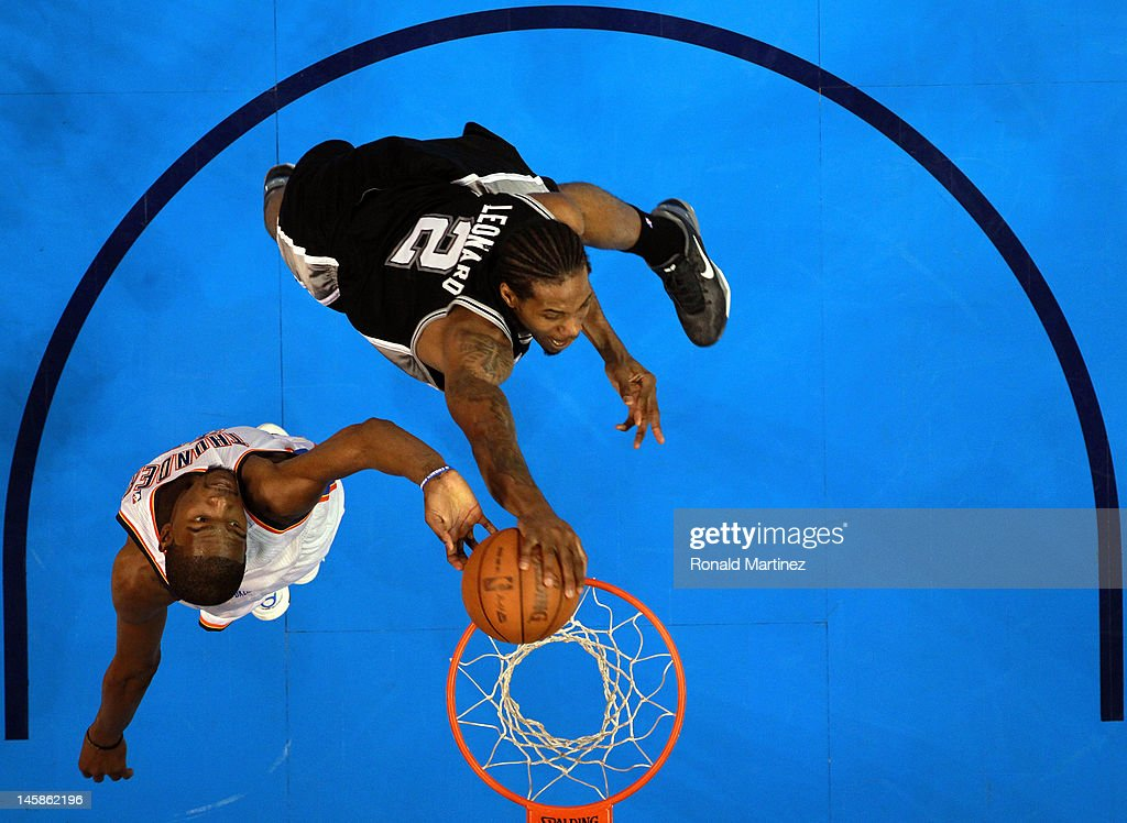<a gi-track='captionPersonalityLinkClicked' href=/galleries/search?phrase=Kevin+Durant&family=editorial&specificpeople=3847329 ng-click='$event.stopPropagation()'>Kevin Durant</a> #35 of the Oklahoma City Thunder blocks the dunk of <a gi-track='captionPersonalityLinkClicked' href=/galleries/search?phrase=Kawhi+Leonard&family=editorial&specificpeople=6691012 ng-click='$event.stopPropagation()'>Kawhi Leonard</a> #2 of the San Antonio Spurs in Game Six of the Western Conference Finals of the 2012 NBA Playoffs at Chesapeake Energy Arena on June 6, 2012 in Oklahoma City, Oklahoma.