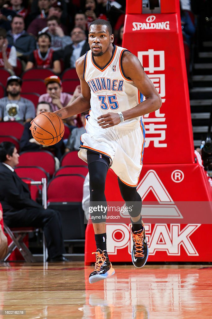 Kevin Durant #35 of the Oklahoma City Thunder brings the ball up court against the Houston Rockets on February 20, 2013 at the Toyota Center in Houston, Texas.