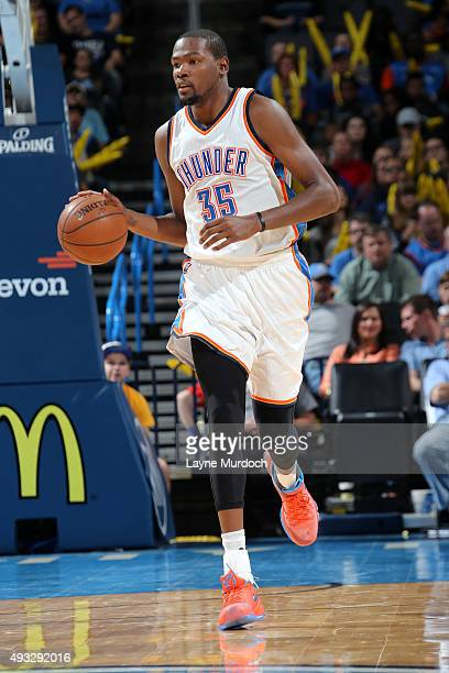 Kevin Durant of the Oklahoma City Thunder brings the ball up court against the Denver Nuggets during a preseason game on October 18 2015 at...