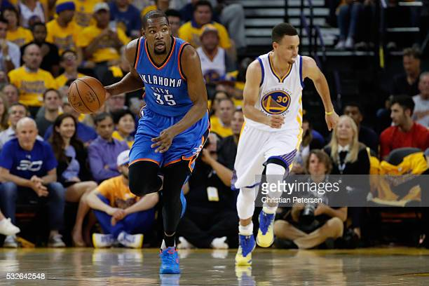 Kevin Durant of the Oklahoma City Thunder brings the ball upcourt ahead of Stephen Curry of the Golden State Warriors during game two of the Western...
