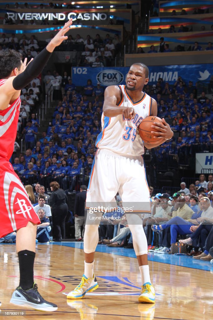 <a gi-track='captionPersonalityLinkClicked' href=/galleries/search?phrase=Kevin+Durant&family=editorial&specificpeople=3847329 ng-click='$event.stopPropagation()'>Kevin Durant</a> #35 of the Oklahoma City Thunder calls a play against the Houston Rockets in Game Two of the Western Conference Quarter Finals during the 2013 NBA playoffs on April 24, 2013 at the Chesapeake Energy Arena in Oklahoma City, Oklahoma.