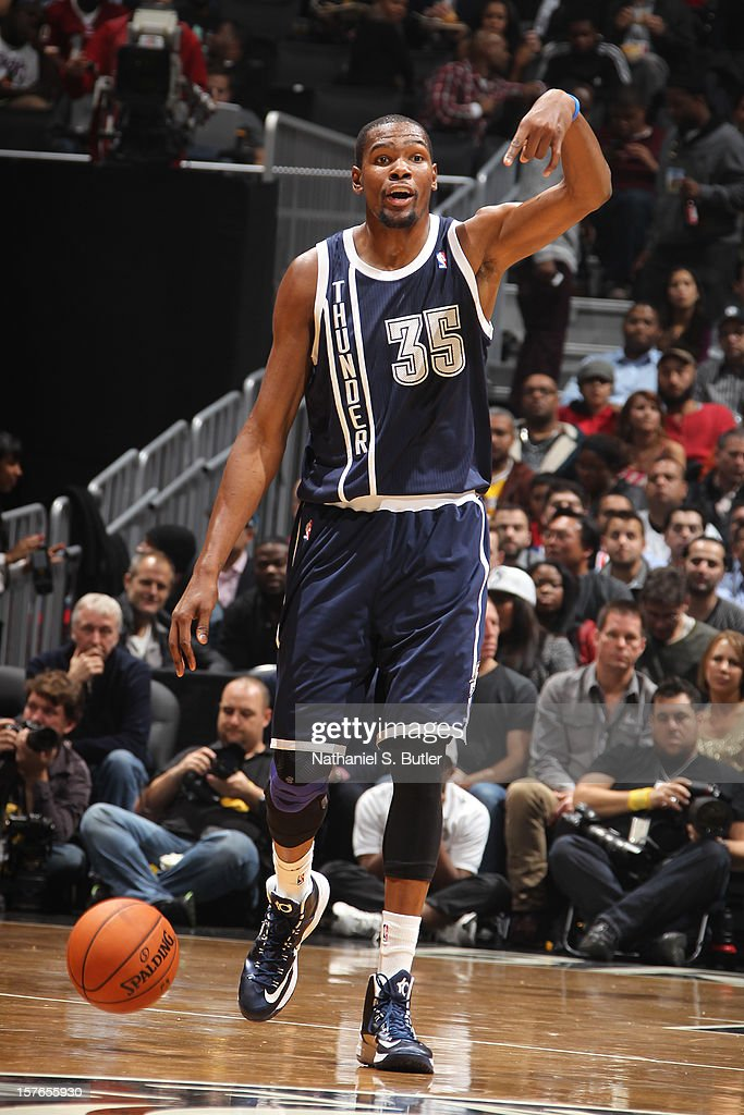 <a gi-track='captionPersonalityLinkClicked' href=/galleries/search?phrase=Kevin+Durant&family=editorial&specificpeople=3847329 ng-click='$event.stopPropagation()'>Kevin Durant</a> #35 of the Oklahoma City Thunder calls out a play during the game against the Brooklyn Nets on December 4, 2012 at the Barclays Center in the Brooklyn Borough of New York City.