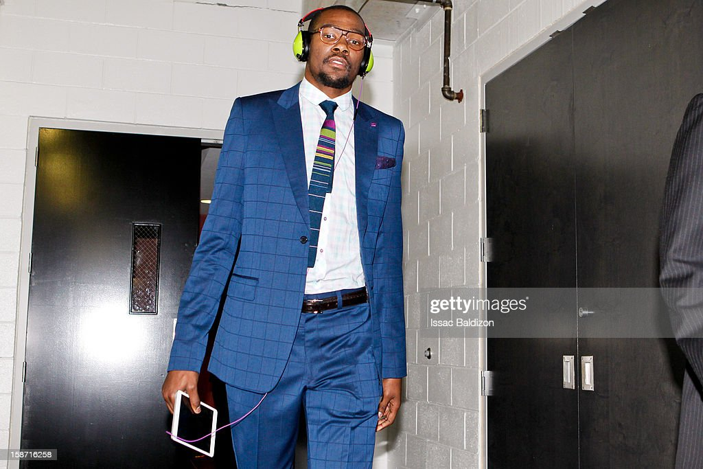 Kevin Durant #35 of the Oklahoma City Thunder carries an Apple Inc. iPad before playing against the Miami Heat in a Christmas Day game on December 25, 2012 at American Airlines Arena in Miami, Florida.
