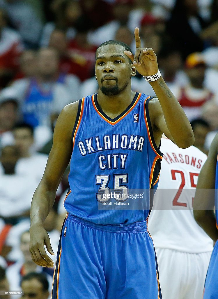<a gi-track='captionPersonalityLinkClicked' href=/galleries/search?phrase=Kevin+Durant&family=editorial&specificpeople=3847329 ng-click='$event.stopPropagation()'>Kevin Durant</a> #35 of the Oklahoma City Thunder celebrates a shot against the Houston Rockets in Game Three of the Western Conference Quarterfinals of the 2013 NBA Playoffs at the Toyota Center on April 27, 2013 in Houston, Texas.
