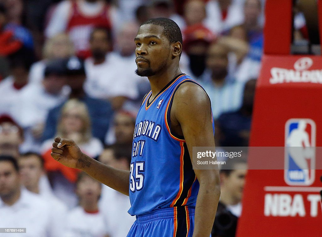 <a gi-track='captionPersonalityLinkClicked' href=/galleries/search?phrase=Kevin+Durant&family=editorial&specificpeople=3847329 ng-click='$event.stopPropagation()'>Kevin Durant</a> #35 of the Oklahoma City Thunder celebrates a shot in the fourth quarter against the Houston Rockets in Game Three of the Western Conference Quarterfinals of the 2013 NBA Playoffs at the Toyota Center on April 27, 2013 in Houston, Texas.