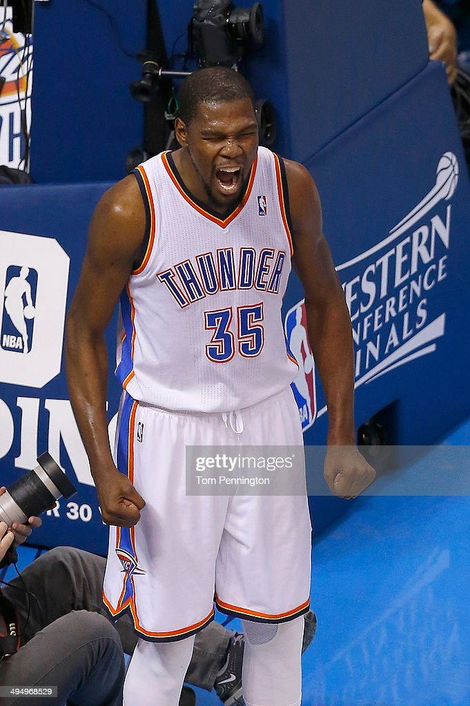 <a gi-track='captionPersonalityLinkClicked' href=/galleries/search?phrase=Kevin+Durant&family=editorial&specificpeople=3847329 ng-click='$event.stopPropagation()'>Kevin Durant</a> #35 of the Oklahoma City Thunder celebrates after a play against the San Antonio Spurs in the first half during Game Six of the Western Conference Finals of the 2014 NBA Playoffs at Chesapeake Energy Arena on May 31, 2014 in Oklahoma City, Oklahoma.