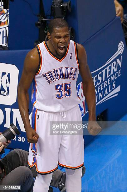 Kevin Durant of the Oklahoma City Thunder celebrates after a play against the San Antonio Spurs in the first half during Game Six of the Western...