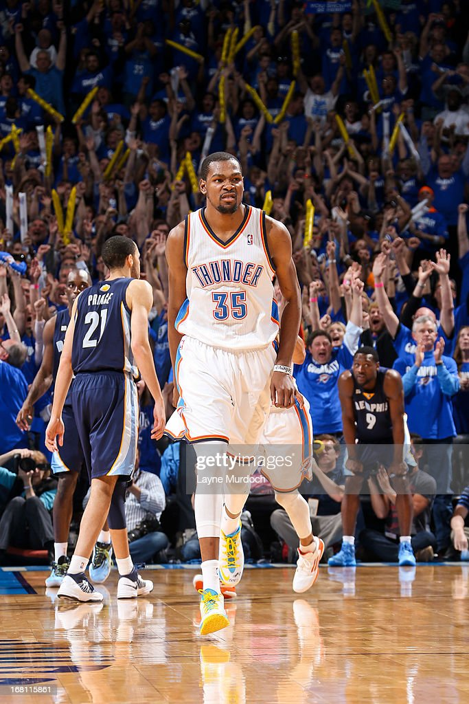 <a gi-track='captionPersonalityLinkClicked' href=/galleries/search?phrase=Kevin+Durant&family=editorial&specificpeople=3847329 ng-click='$event.stopPropagation()'>Kevin Durant</a> #35 of the Oklahoma City Thunder celebrates after making a go-ahead shot late in the fourth quarter, leading to his team's victory, against the Memphis Grizzlies in Game One of the Western Conference Semifinals during the 2013 NBA Playoffs on May 5, 2013 at the Chesapeake Energy Arena in Oklahoma City, Oklahoma.