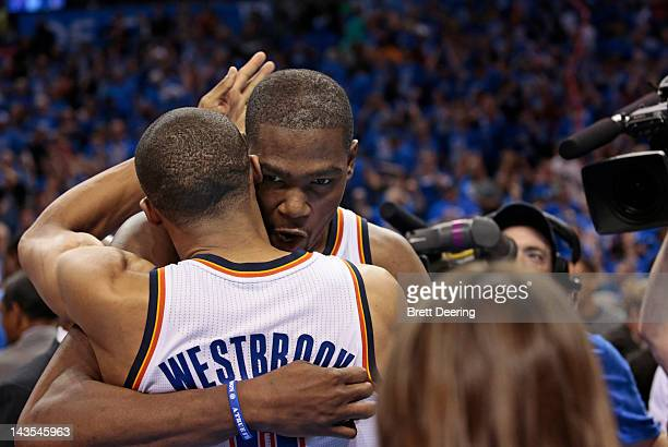 Kevin Durant of the Oklahoma City Thunder celebrates with Russell Westbrook of the Oklahoma City Thunder after beating the Dallas Mavericks in Game...