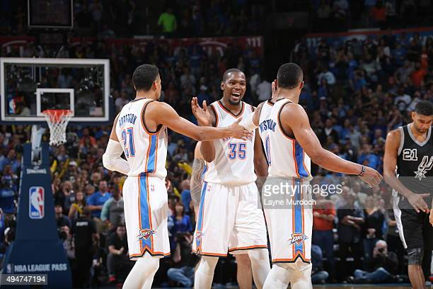Kevin Durant of the Oklahoma City Thunder celebrates with teammates after the game against the San Antonio Spurs on October 18 2015 at Chesapeake...