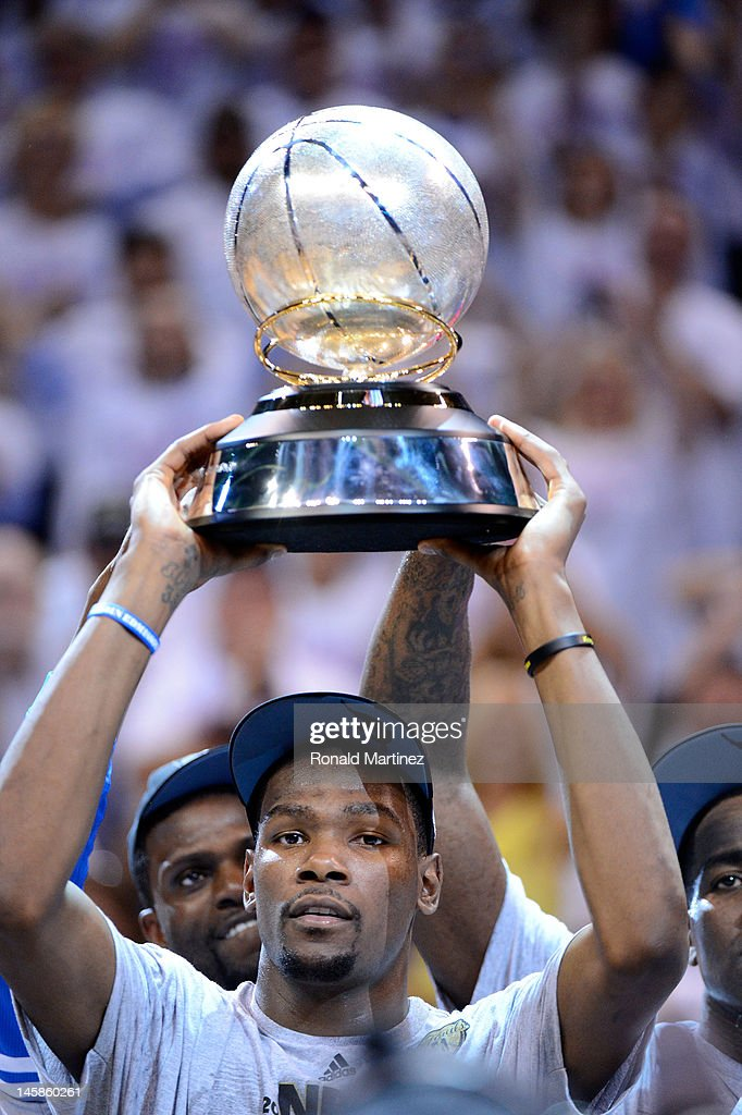 <a gi-track='captionPersonalityLinkClicked' href=/galleries/search?phrase=Kevin+Durant&family=editorial&specificpeople=3847329 ng-click='$event.stopPropagation()'>Kevin Durant</a> #35 of the Oklahoma City Thunder celebrates with the trophy after defeating the San Antonio Spurs to win the Western Conference Finals of the 2012 NBA Playoffs at Chesapeake Energy Arena on June 6, 2012 in Oklahoma City, Oklahoma.