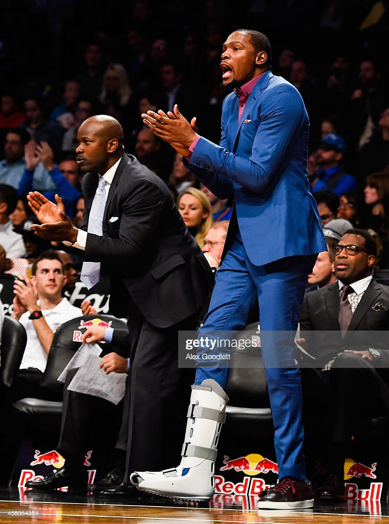 Kevin Durant of the Oklahoma City Thunder cheers in the third quarter during a game against the Brooklyn Nets at the Barclays Center on November 3...