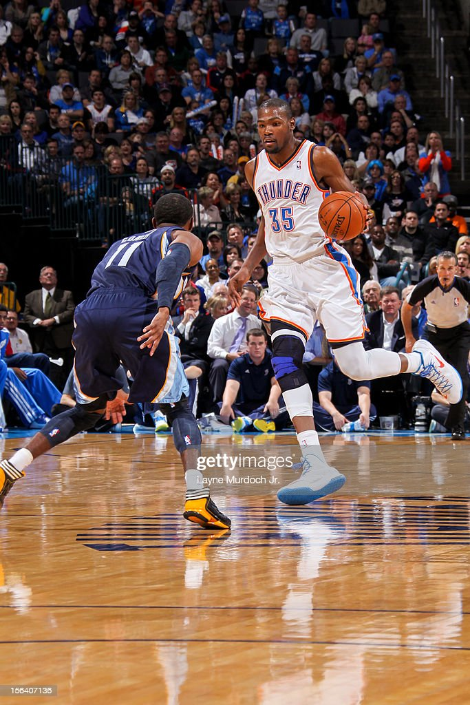 <a gi-track='captionPersonalityLinkClicked' href=/galleries/search?phrase=Kevin+Durant&family=editorial&specificpeople=3847329 ng-click='$event.stopPropagation()'>Kevin Durant</a> #35 of the Oklahoma City Thunder controls the ball against <a gi-track='captionPersonalityLinkClicked' href=/galleries/search?phrase=Mike+Conley+Jr.+-+Basketball+Player&family=editorial&specificpeople=4094526 ng-click='$event.stopPropagation()'>Mike Conley Jr.</a> #11 of the Memphis Grizzlies on November 14, 2012 at the Chesapeake Energy Arena in Oklahoma City, Oklahoma.