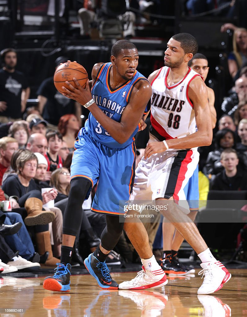 Kevin Durant #35 of the Oklahoma City Thunder controls the ball against Nicolas Batum #88 of the Portland Trail Blazers on January 13, 2013 at the Rose Garden Arena in Portland, Oregon.