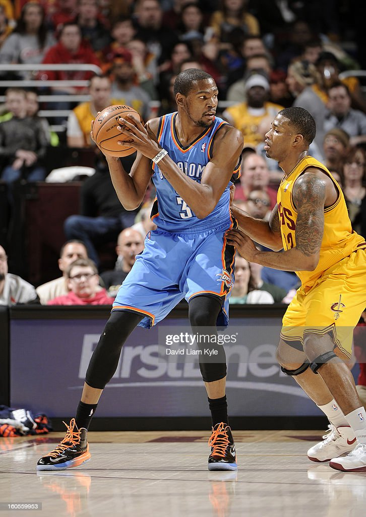 Kevin Durant #35 of the Oklahoma City Thunder controls the ball against Alonzo Gee #33 of the Cleveland Cavaliers at The Quicken Loans Arena on February 2, 2013 in Cleveland, Ohio.