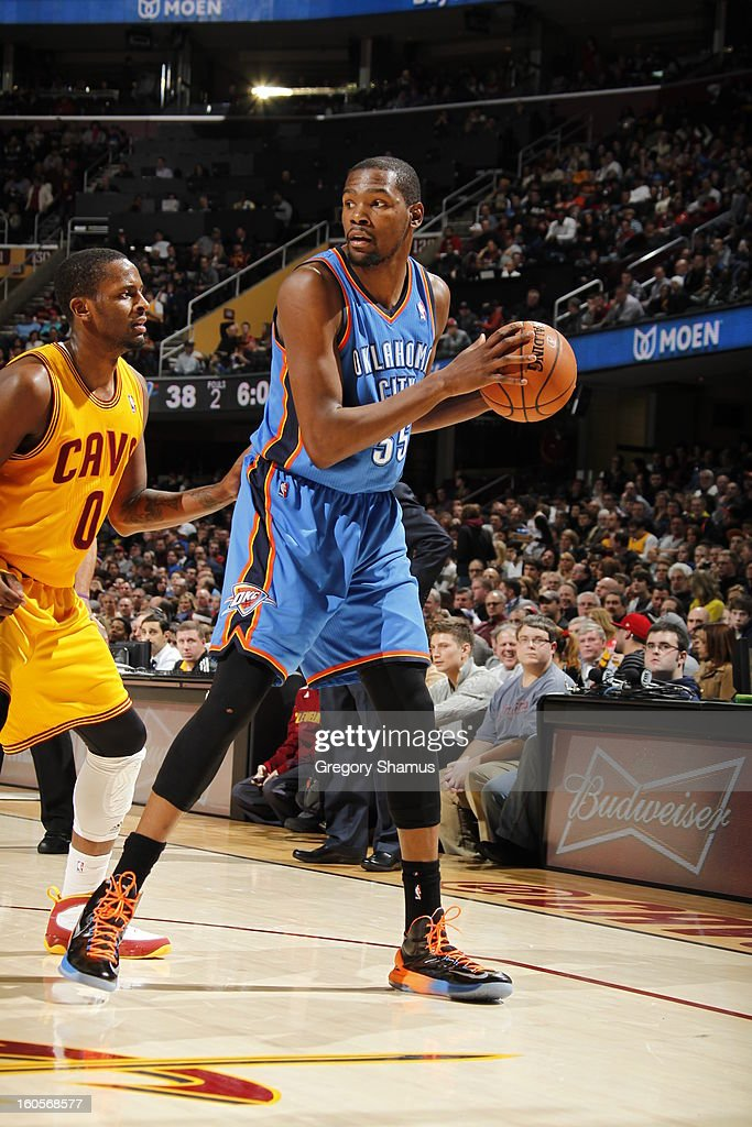 Kevin Durant #35 of the Oklahoma City Thunder controls the ball against C.J. Miles #0 of the Cleveland Cavaliers at The Quicken Loans Arena on February 2, 2013 in Cleveland, Ohio.