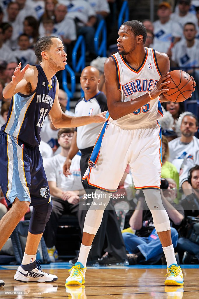 Kevin Durant #35 of the Oklahoma City Thunder controls the ball against Tayshaun Prince #21 of the Memphis Grizzlies in Game Five of the Western Conference Semifinals during the 2013 NBA Playoffs on May 15, 2013 at the Chesapeake Energy Arena in Oklahoma City, Oklahoma.