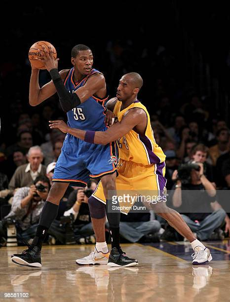 Kevin Durant of the Oklahoma City Thunder controls the ball against Kobe Bryant of the Los Angeles Lakers during Game Two of the Western Conference...