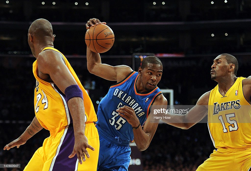 <a gi-track='captionPersonalityLinkClicked' href=/galleries/search?phrase=Kevin+Durant&family=editorial&specificpeople=3847329 ng-click='$event.stopPropagation()'>Kevin Durant</a> #35 of the Oklahoma City Thunder cuts between Metta World Peace #15 and <a gi-track='captionPersonalityLinkClicked' href=/galleries/search?phrase=Kobe+Bryant&family=editorial&specificpeople=201466 ng-click='$event.stopPropagation()'>Kobe Bryant</a> #24 of the Los Angeles Lakers at Staples Center on March 29, 2012 in Los Angeles, California.