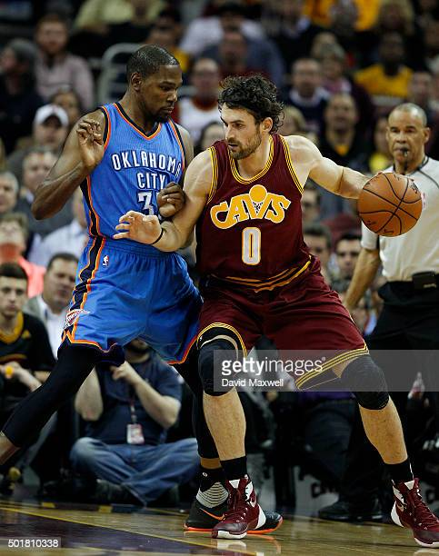 Kevin Durant of the Oklahoma City Thunder defends against Kevin Love of the Cleveland Cavaliers during the first half of their game on December 17...
