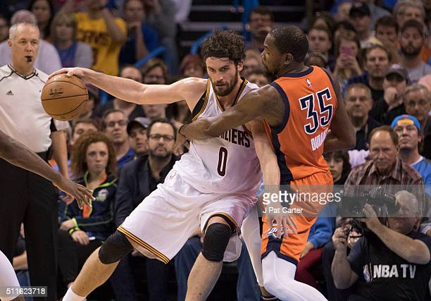 Kevin Durant of the Oklahoma City Thunder defends against Kevin Love of the Cleveland Cavaliers during the fourth quarter of a NBA game at the...