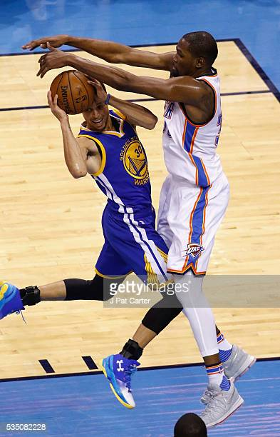 Kevin Durant of the Oklahoma City Thunder defends Stephen Curry of the Golden State Warriors during the first half in game six of the Western...