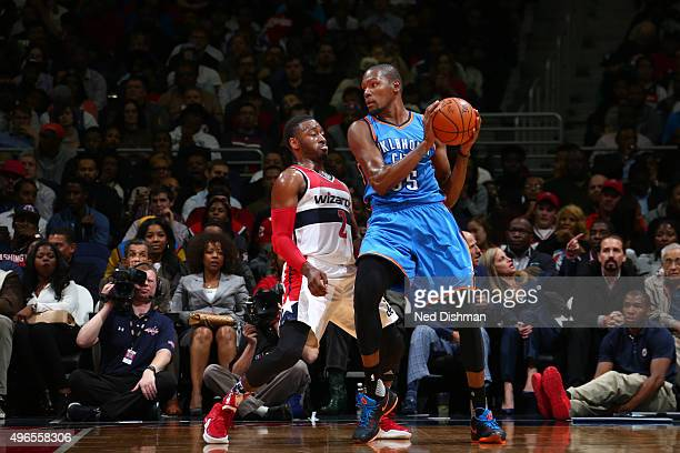 Kevin Durant of the Oklahoma City Thunder defends the ball against John Wall of the Washington Wizards during the game on November 10 2015 at Verizon...