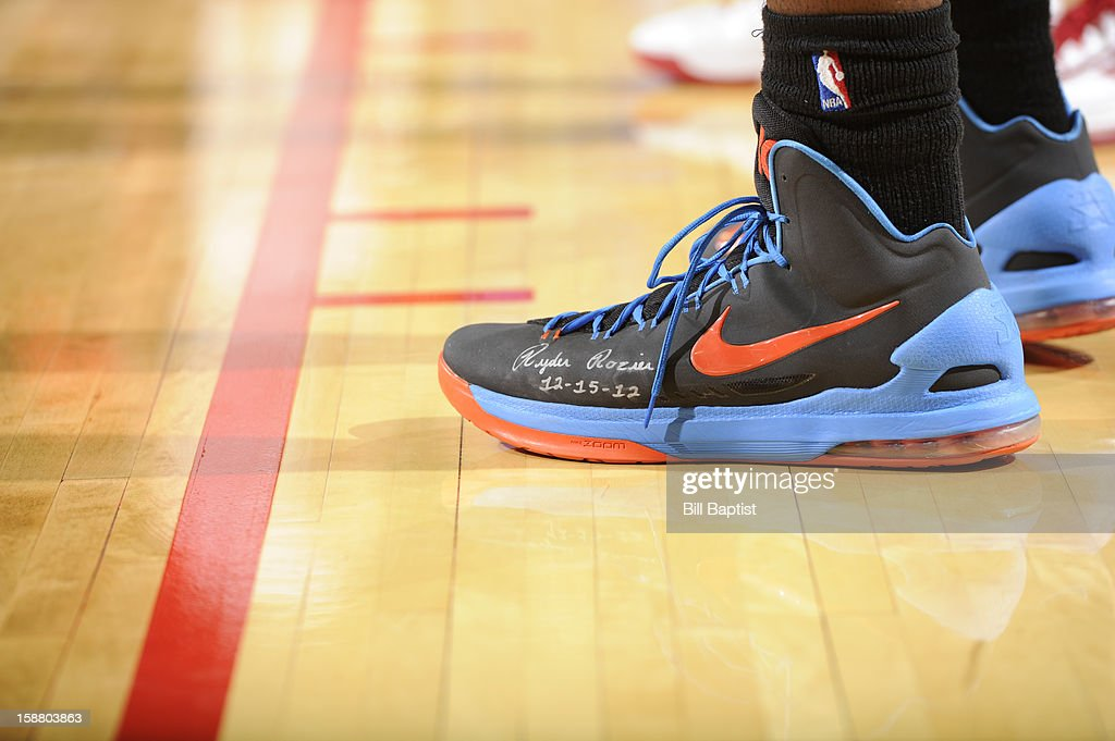 Kevin Durant #35 of the Oklahoma City Thunder displays the name of Ryder Rozier, a 3-year-old who died after accidentally shooting himself on December 15, 2012 with a family member's handgun, on his shoe during the game against the Houston Rockets on December 29, 2012 at the Toyota Center in Houston, Texas.