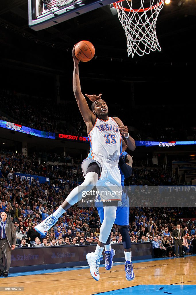 Kevin Durant #35 of the Oklahoma City Thunder draws contact while making a layup against the Dallas Mavericks on December 27, 2012 at the Chesapeake Energy Arena in Oklahoma City, Oklahoma.